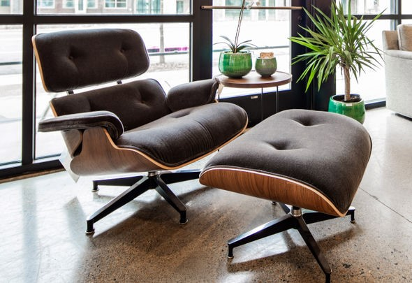 The Eames Lounge chair with its display of leather and wood grain remains an office and home favorite today.