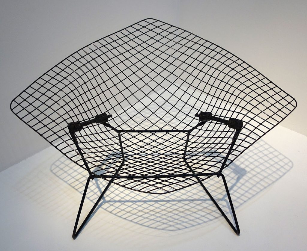 Harry Bertoia's fascination with metal resulted in the most stripped down, but beautiful chair yet, the Diamond Chair.