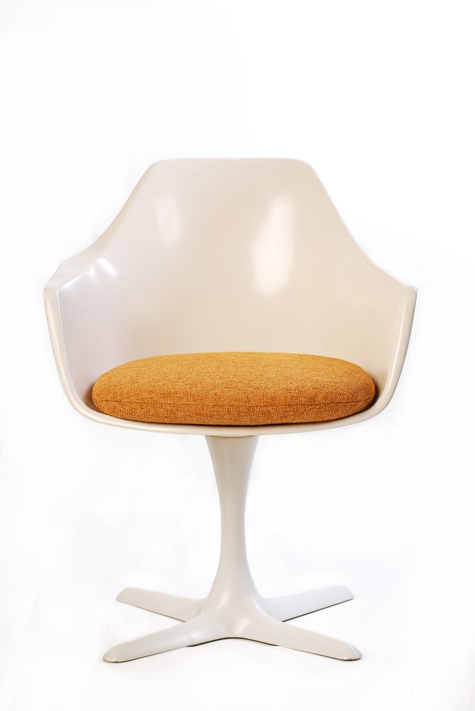 The Tulip Chair, designed by architect and artist Eero Saarinen, began to appear in every 1960's kitchen.